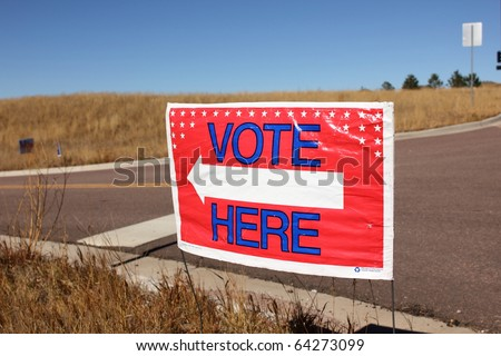 Vote Here Sign on Election Day - stock photo