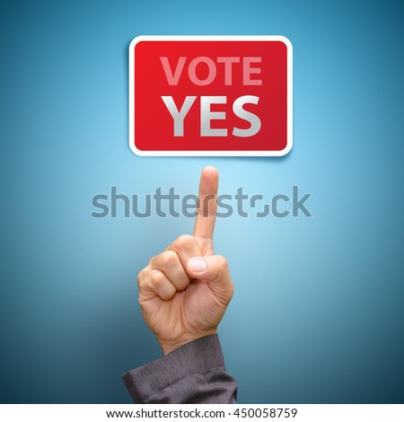 Vote yes concept : finger Pointing to vote yes - stock photo