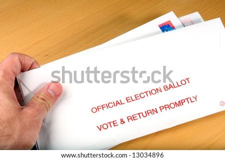 Voter receiving ballot through mail - stock photo