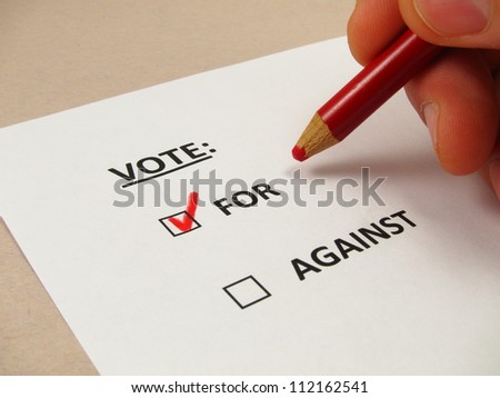 Voting ballot with 'for' box checked - stock photo