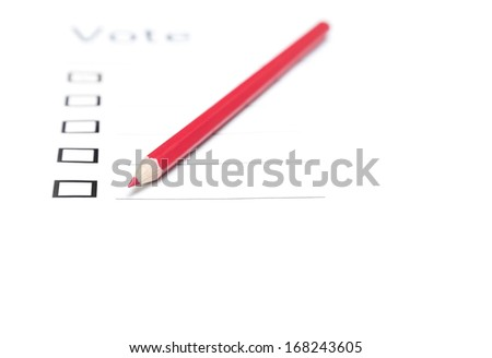 Voting bulletin with red pencil to make choice. Close-up photo