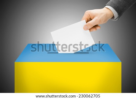 Voting concept - Ballot box painted into national flag colors - Ukraine