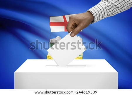 Voting concept - Ballot box with Canadian province flag on background - Alberta - stock photo