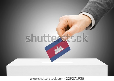 Voting concept - Male inserting flag into ballot box - Cambodia - stock photo