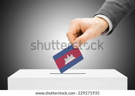 Voting concept - Male inserting flag into ballot box - Cambodia - stock photo