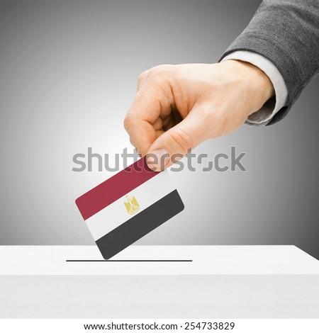 Voting concept - Male inserting flag into ballot box - Egypt - stock photo