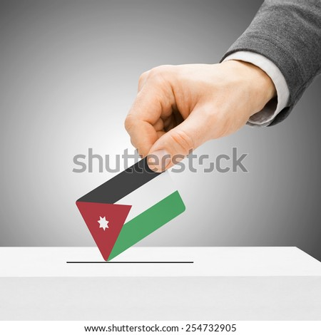 Voting concept - Male inserting flag into ballot box - Jordan - stock photo