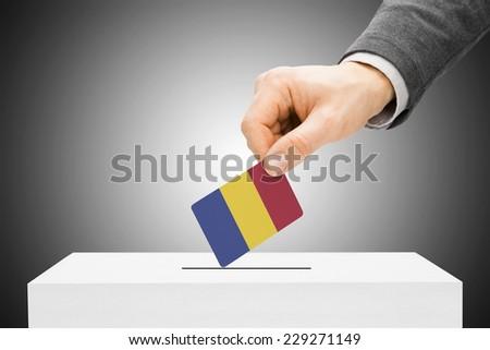 Voting concept - Male inserting flag into ballot box - Romania - stock photo