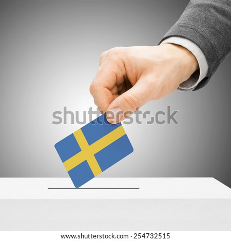 Voting concept - Male inserting flag into ballot box - Sweden - stock photo