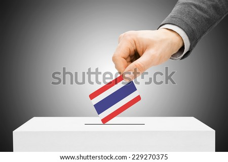Voting concept - Male inserting flag into ballot box - Thailand - stock photo