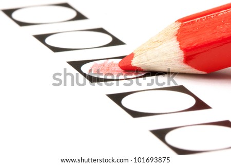 Voting form with red pencil filling in a black circle - stock photo