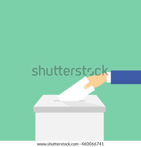 Voting. Hand puts the ballot in the ballot box - stock photo