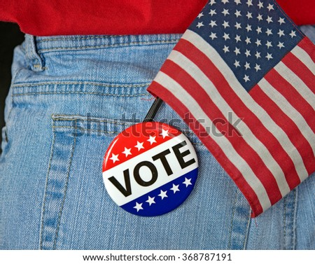 voting pin on blue jean pocket with an American flag