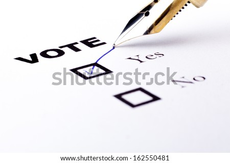 Voting yes or no check-box with fountain pen yes marked with V  - stock photo