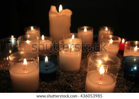 Votive candles, burning in a French Roman Catholic church