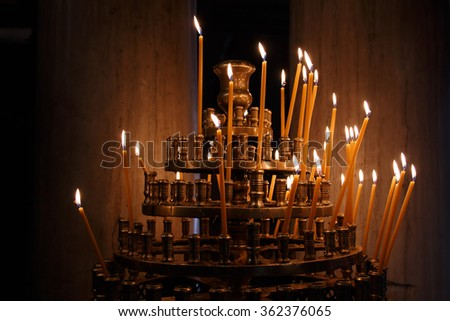 Votive candles in orthodox church - stock photo