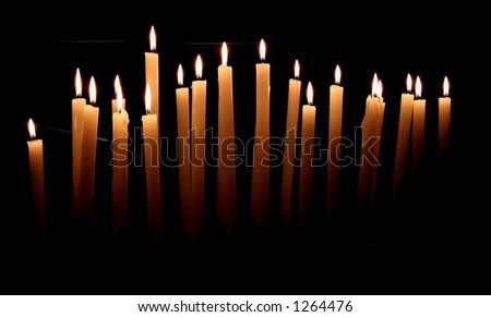 Votive candles in the church - stock photo