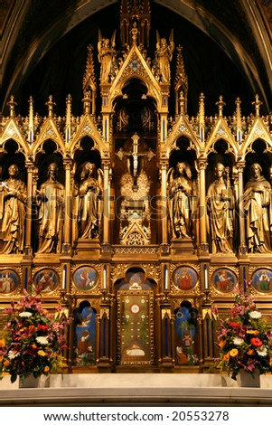 Votivkirche in Vienna, Austria - one of the most important neo-Gothic religious architectural sites in the world. Main altar. - stock photo