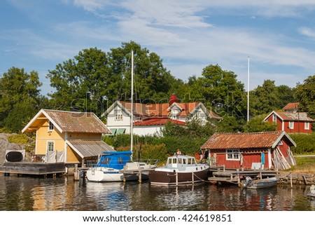 VOXHOLM / SWEDEN - JULY 2013: Small harbor of Voxholm village, Sweden - stock photo