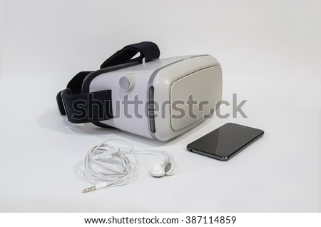 Vr headset with a mobile phone and headphones. Virtual reality equipment for home