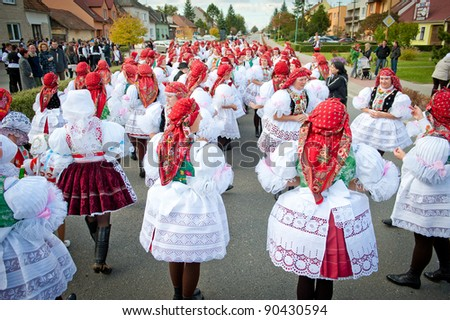 VRACOV - OCTOBER 15: People nad children in folk costume on The biggest folk feast in Czech Republic, Oct 15, 2011 in Vracov, Czech Republic. Feast Vracov - stock photo