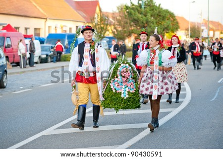VRACOV - OCTOBER 15: Starek and Starka hold bell and walk in parade on The biggest folk feast in Czech Republic, Oct 15, 2011 in Vracov, Czech Republic. Feast Vracov - stock photo