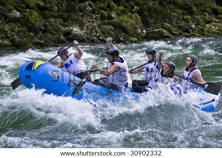 VRBAS, REPUBLIKA SRPSKA, BOSNIA - MAY 23: Team Bosnia Herzegovina in action on the 6th day night race slalom competition at World Rafting Champs Banja Luka 2009 May 23, 2009 in Vrbas.