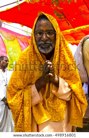 Vrindavan - March 1, 2013: Local sadhu welcomes guests, at the time after Gaura Purnima festival