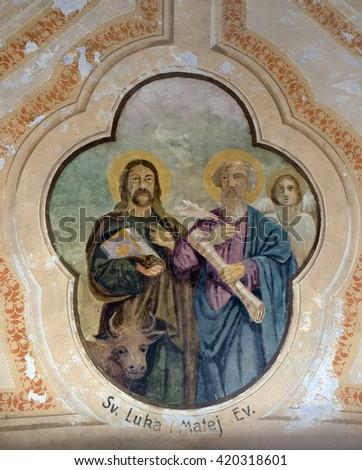 VUGROVEC, CROATIA - OCTOBER 02: Saint Luke and Saint Matthew the Evangelist, fresco in the Church of Saint Saint Michael in Vugrovec, Croatia on October 02, 2015 - stock photo