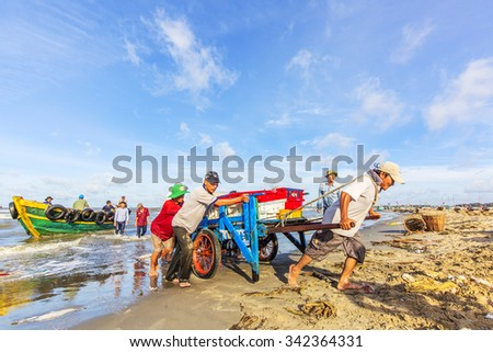 VUNG TAU, VIETNAM - AUG 22,2015: Fishermen on beach at the Fishing Village Long Hai, Vietnam.