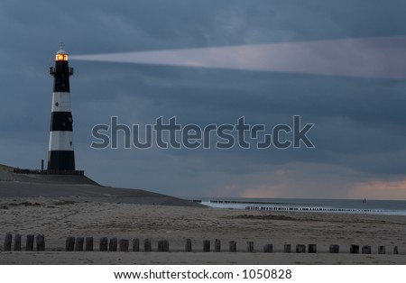 Vuurtoren Breskens lighthouse in the Netherlands shining in the night. - stock photo