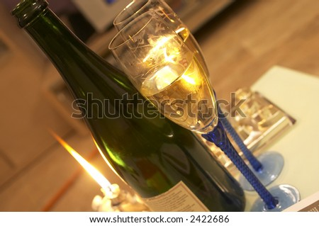 vview of two flutes glass and a bottle of Champagne - stock photo