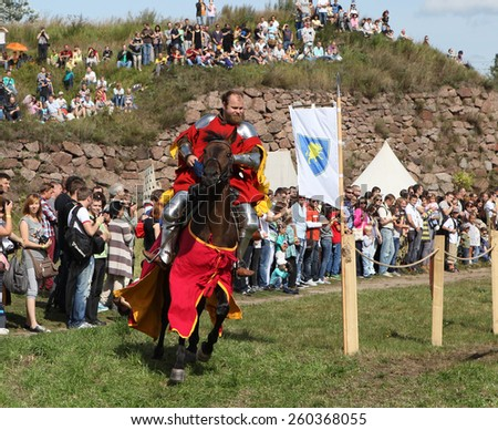 VYBORG, RUSSIA - AUGUST 17, 2013: Photo of Equestrian tournament of knights.