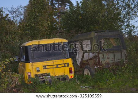 VYBORG, RUSSIA - OCTOBER 3, 2015: Old broken off-road cars UAZ are in green thickets, villas Kirov, Vyborg, Russia - stock photo