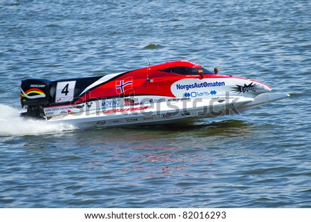 VYSHGOROD, UKRAINE -  JULY 29 : Powerboat number 4, Team Nautica  F1 fast speed. Grand Prix Formula 1 H2O World Championship Powerboat on July 29, 2011 in Vyshgorod, Ukraine .