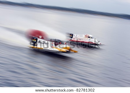 VYSHGOROD, UKRAINE - JULY 30: Team Abu Dhabi driver Ahmed Al Hameli , #6 from UAE and Philippe Chiappe (FRA), #7 on GrandPrix Formula 1 H2O World Championship Powerboat on July 30, 2011 in Ukraine . - stock photo