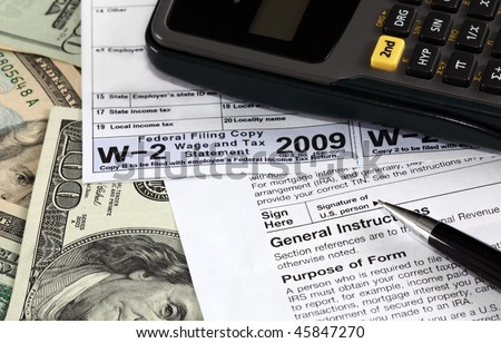 W-2 and W-9 Forms on US dollars - stock photo