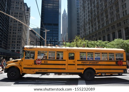 W YORK CITY - AUGUST 07: School bus in Manhattan, NY on August 07, 2013. NYC School Bus Drivers union 1181 still on strike form January 16, 2013 - stock photo