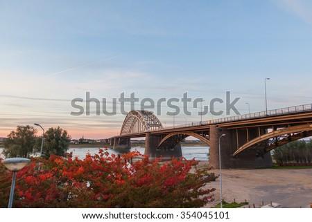 Waal bridge at sunset, Nijmegen Netherlands - stock photo