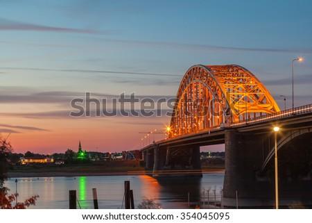 Waal bridge light up at dusk twilight - stock photo