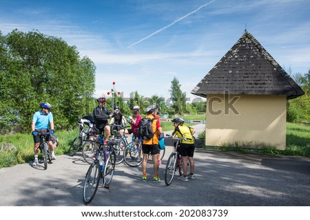 WACHAU VALLEY,AUSTRIA-MAY 9,2014:group of cyclists is resting at cycle path near danube river in Austria during a sunny day - stock photo