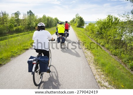 WACHAU VALLEY,AUSTRIA-MAY 8,2015:People are riding bcycle at cycle path near danube river in Austria during a sunny day - stock photo