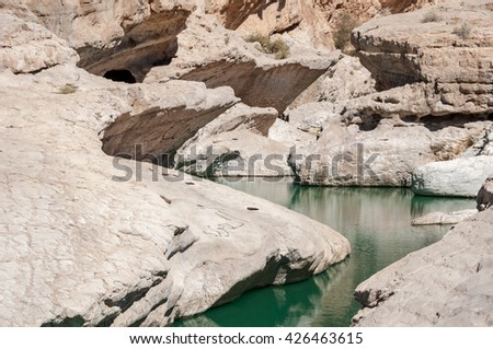 Wadi Bani Khalid - Desert and water - In close proximity to Oman desert, a perennial source of fresh water and its canyons. - stock photo