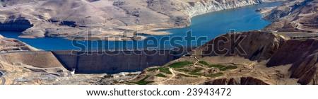 Wadi Mujib - King 's road area, highway  on the water dam with desert landscape around it in Jordan. - stock photo