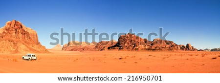 Wadi Rum also known as The Valley of the Moon. It is a valley cut into the sandstone and granite rock in southern Jordan 60 km to the east of Aqaba; it is the largest wadi in Jordan. - stock photo