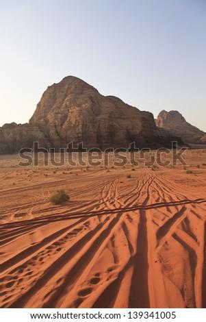 Wadi Rum desert and the tracks of 4X4 - stock photo