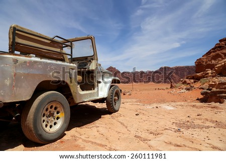 WADI RUM DESERT, JORDAN- APRIL 10, 2014: Car in the Wadi Rum Desert -- also known as The Valley of the Moon is a valley cut into the sandstone and granite rock in southern Jordan