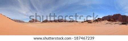 Wadi Rum Desert (panoramic view) also known as The Valley of the Moon is a valley cut into the sandstone and granite rock in southern Jordan 60 km to the east of Aqaba - stock photo