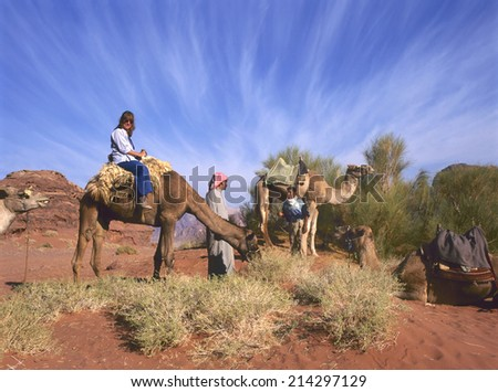 WADI RUM, JORDAN-OCTOBER 22, 2010; Camel ride in the Wadi Rum desert of Jordan.October 22,2010 Wadi Rum, Jordan. - stock photo