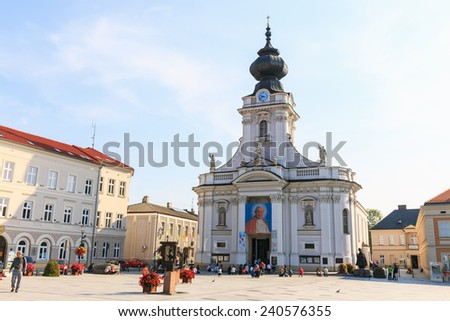 Wadowice, Poland - September 07, 2014: Tourists visit the city center of Wadowice. Wadowice is the place of birth of Pope John Paul II - stock photo